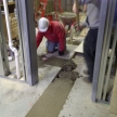 #30-april-5-workmen-pouring-concrete-on-basement-floor
